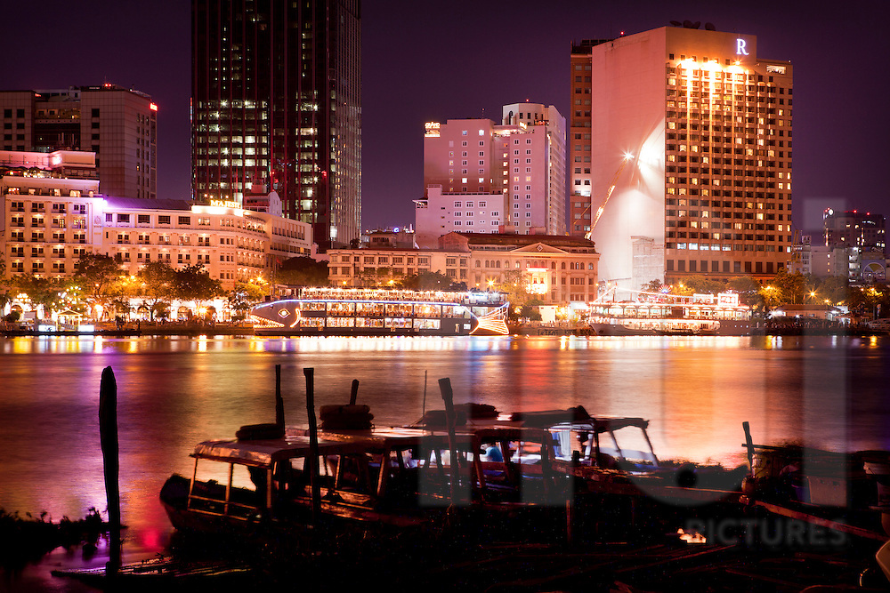 Ho Chi Minh city cityscape and skyline at night from the Saigon River. Vietnam, Asia