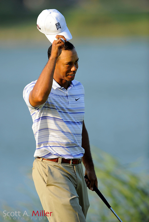 Aug 14, 2009; Chaska, MN, USA; Tiger Woods (USA) tips his cap to the gallery after making a birdie putt on the 16th hole during the second round of the 2009 PGA Championship at Hazeltine National Golf Club.  ©2009 Scott A. Miller