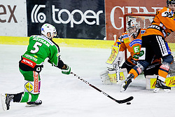 Scott Hotham (HDD Tilia Olimpija, #5) scores a goal during ice-hockey match between HDD Tilia Olimpija and Moser Medical Graz 99ers in 42nd Round of EBEL league, on Januar 15, 2012 at Hala Tivoli, Ljubljana, Slovenia. HDD Tilia Olimpija defeated Moser Medical Graz 99ers 4:2. (Photo By Matic Klansek Velej / Sportida)