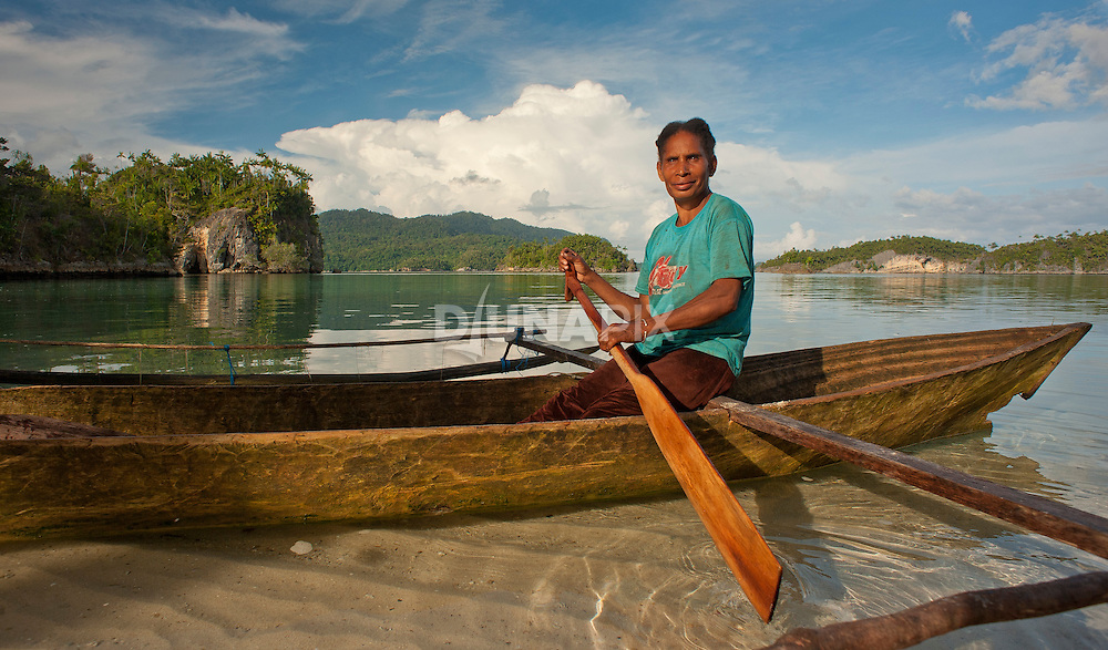 A fisher woman makes camp at Temintoi, Triton Bay, Papua.