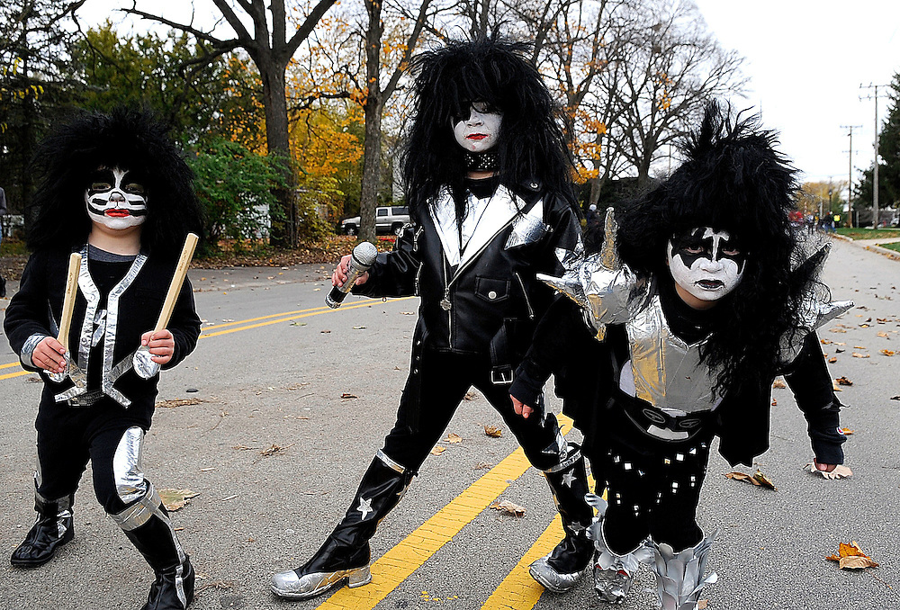Photo By Michael R. Schmidt.Aaron (from left) 4 Brett, 7, and Troy, 4, Bosak of Minooka dress up as KISS band members Peter Criss, Paul Stanley and Gene Simmons during Minooka's first ever Halloween parade Saturday afternoon.
