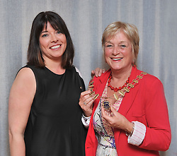 Accecpting the chain of office... Joan Collins outgoing President of Westport Lions Club is pictured presenting Ronnie Doyle newly elected president with the Chain of Office after the recent agm.<br /> Pic Conor McKeown