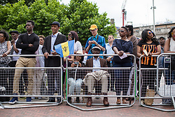 © Licensed to London News Pictures. 22/06/2017. London, UK. An elderly couple with the Barbados flag attend the inauguration of the African Caribbean War Memorial in Windrush Square in Brixton, south London, on Windrush Day. The memorial remembers the many African and Caribbean servicemen that fought in the Second World War. Photo credit: Rob Pinney/LNP