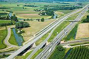 Nederland, Gelderland, Neder-Betuwe, 28-06-2006; ten Oosten van Geldermalsen, voltooide Betuweroute, parallel aan A15; autosnelweg en goederenspoorlijn worden over de spoorlijn Tiel-Geldermalsen heen geleid; het kronkelende riviertje is de Linge, met historische watermolen (monument bouw, transport, infrastructuur, infrabundel, meander, verkeer en vervoer, mobiliteit, planologie; zie ook andere (lucht)foto's van deze lokatie, deel van de serie Panorama Nederland luchtfoto (toeslag aerial photo (additional fee required .foto Siebe Swart / photo Siebe Swart