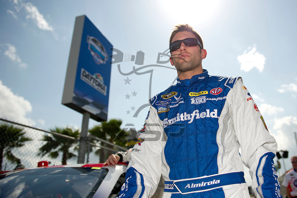 Daytona Beach, FL - FEB 19, 2012:  Aric Almirola (43) gets out of the car during qualifying for the Daytona 500 at the Daytona International Speedway in Daytona Beach, FL.