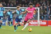 Hartlepool United Midfielder, Josh Laurent (28) takes on Wycombe Wanderers Midfielder, Dominic Gape (25) during the EFL Sky Bet League 2 match between Wycombe Wanderers and Hartlepool United at Adams Park, High Wycombe, England on 26 November 2016. Photo by Adam Rivers.
