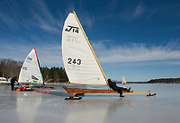 Waiting for the wind in the sunshine on a J14 with the New England Yacht Association for a day of ice sailing on Lake Winnipesaukee from Ames Farm Inn beach.  (Karen Bobotas Photographer)