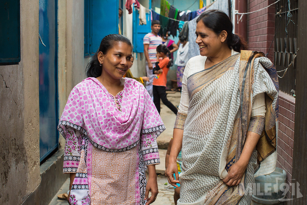Nazma Akter (right) and Khadiza Akter out visting garment workers in Dhaka, Bangladesh. <br /> <br /> Nazma is the President of Awaj Foundation. The Foundation was founded by Zazma in 2003 to support and empower garment workers to negotiate safer and fairer working conditions.) out visting garment workers in Dhaka, Bangladesh.