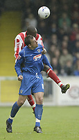 Photo: Aidan Ellis.<br /> Lincoln City v Grimsby Town. Coca Cola League 2, Play off Semi Final. 13/05/2006.<br /> Lincoln's Nat Brown beats Grimsby's Gary Jones to the ball