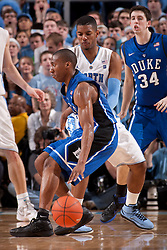 CHAPEL HILL, NC - MARCH 05: Nolan Smith #2 of the Duke Blue Devils dribbles the ball while pressured by Leslie McDonald #2 of the North Carolina Tar Heels on March 05, 2011 at the Dean E. Smith Center in Chapel Hill, North Carolina. North Carolina won 67-81. (Photo by Peyton Williams/UNC/Getty Images) *** Local Caption *** Nolan Smith;Leslie McDonald