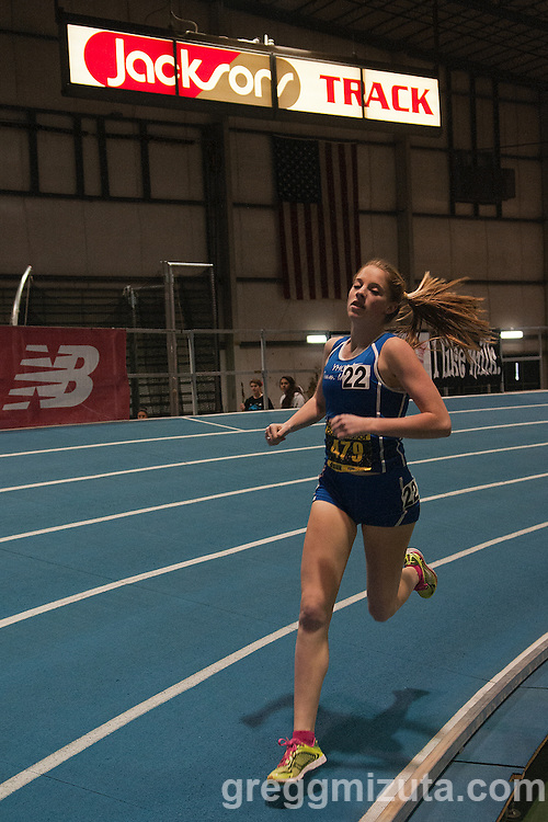 Sam McKinnon has the lead during the New Balance Boise Indoor girls 1 mile race at Jacksons Track in the Idaho Center in Nampa, Idaho on January 25, 2014.<br />