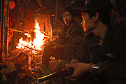 Hmong soldiers camped in the remote jungle, near Vang Vieng, Laos, June 26, 2006. ..**EXCLUSIVE, no tabloids without permission**  .Pictured are a group of Hmong people who report an attack against them April 6, 2006 by Lao and Vietnamese military forces.  26 people perished, 5 were injured, and 5 babies died shortly after because their dead mothers could not breast-feed them.  Only one adult male was killed, the other 25 victims were women and children (17 children).  The Lao Spokesman for the Ministry of Foreign Affairs says this is a fabrication, an investigation has been completed, and there was no attack.  The Hmong group says no officials have interviewed witnesses or visited the crime scene, a point the Lao Spokesman did not deny.  ..The Hmong people pictured have hidden in remote mountains of Laos for more than 30 years, afraid to come out.  At least 12,000 are said to exist, with little food, scavenging in the jungle. Most have not seen the modern world.  The CIA trained and funded many Hmong hill tribes in Laos from 1961 to 1973 to fight communism.  The Hmong suffered massive casualties defending their homeland and rescuing US pilots.  When America withdrew from the conflict most Hmong were left alone to face the might of the North Vietnamese Army.  The Royal Lao Government fell to the communists and the Hmong became outcasts in the country they fought to defend.  Since 1975, under the communists, thousands of reports evidence the Hmong have suffered frequent persecution, torture, mass executions, imprisonment, and possible chemical weapons attacks.  Reports of these atrocities continue to this day.  The Lao Government generally denies the jungle people exist or that any of this is happening.  The Hmong group leader, Blia Shoua Her, says they are not part of the Hmong resistance and want peace.  He claims they are just civilians defending their families, hoping to surrender to the UN....