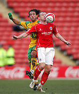 London - Saturday, January 12th, 2008: Grant McCann of Barnsley and Darel Russell of Norwich City during the Coca Cola Champrionship match at Oakwell, Barnsley. (Pic by Paul Hollands/Focus Images)