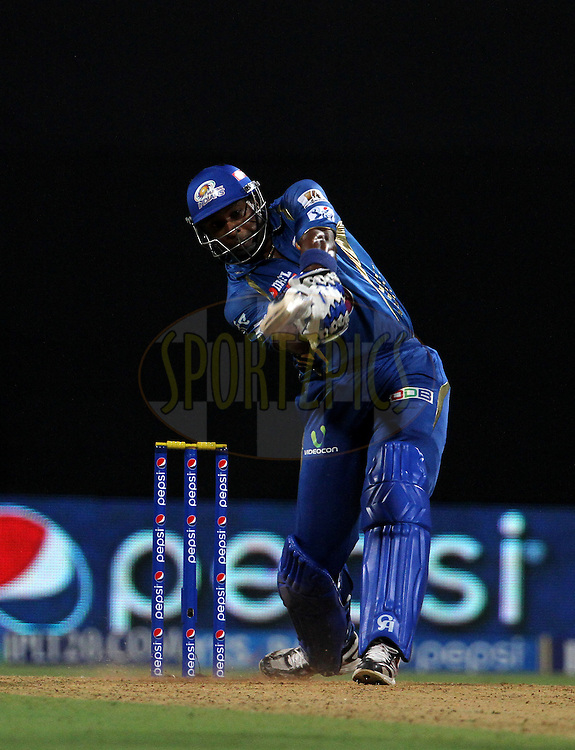 Kieron Pollard of the Mumbai Indians plays a shot during match 22 of the Pepsi Indian Premier League Season 2014 between the Mumbai Indians and the Kings XI Punjab held at the Wankhede Cricket Stadium, Mumbai, India on the 3rd May  2014<br /> <br /> Photo by Vipin Pawar / IPL / SPORTZPICS<br /> <br /> <br /> <br /> Image use subject to terms and conditions which can be found here:  http://sportzpics.photoshelter.com/gallery/Pepsi-IPL-Image-terms-and-conditions/G00004VW1IVJ.gB0/C0000TScjhBM6ikg