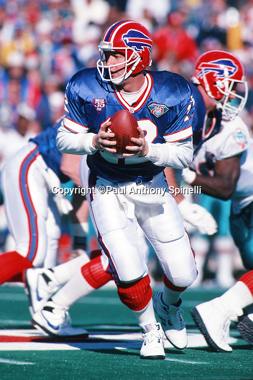 Buffalo Bills quarterback Jim Kelly (12) looks to hand off the ball on a running play during the NFL football game against the Miami Dolphins on Oct. 9, 1994 in Orchard Park, N.Y. The Bills won the game 21-11. (©Paul Anthony Spinelli)
