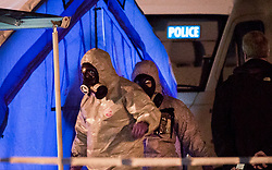 © Licensed to London News Pictures. 06/03/2018. Salisbury, UK. Police are seen in protective suits near The Mill pub and hotel as a cordon is extended around the area where former Russian spy Sergei Skripal and his daughter were taken after becoming ill with suspected poisoning. The couple where found unconscious on bench in Salisbury shopping centre. Specialist units have been called in to deal with any possible contamination. Photo credit: Peter Macdiarmid/LNP