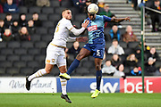 Wycombe Wanderers defender Anthony Stewart (5) heads clear under pressure from Milton Keynes Dons forward (on loan from Norwich) Carlton Morris (23) during the EFL Sky Bet League 1 match between Milton Keynes Dons and Wycombe Wanderers at stadium:mk, Milton Keynes, England on 1 February 2020.