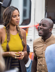 © Licensed to London News Pictures. 20/07/2015. London, UK. Xtra Factor hosts Rochelle Humes (left) and Melvin Odoom (right) filming a segment outside the SSE Arena in Wembley where additional X Factor auditions are being held. Photo credit : James Gourley/LNP