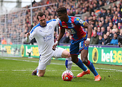 Wilfried Zaha of Crystal Palace is challenged by Christian Fuchs of Leicester City - Mandatory byline: Paul Terry/JMP - 19/03/2016 - FOOTBALL - Selhurst Park - London, England - Crystal Palace v Leicester City - Barclays Premier League