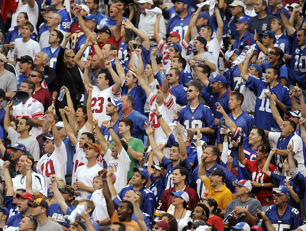 EAST RUTHERFORD, NJ - SEPTEMBER 13: Fans of the New York Giants cheer during a game between the New York Giants and the Washington Redskins on September 13, 2009 at Giants Stadium in East Rutherford, New Jersey. (Photo by Rob Tringali) *** Local Caption ***