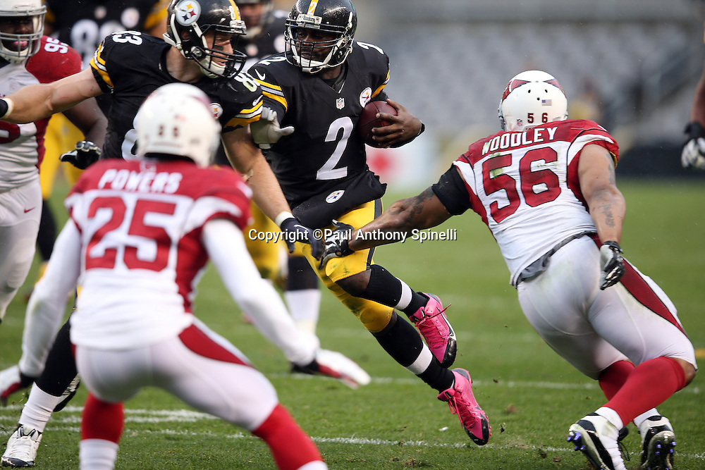 Pittsburgh Steelers quarterback Mike Vick (2) runs a keeper for a first down in Arizona Cardinals territory while trying to avoid a tackle attempt by Arizona Cardinals outside linebacker LaMarr Woodley (56) during the 2015 NFL week 6 regular season football game against the Arizona Cardinals on Sunday, Oct. 18, 2015 in Pittsburgh. The Steelers won the game 25-13. (©Paul Anthony Spinelli)