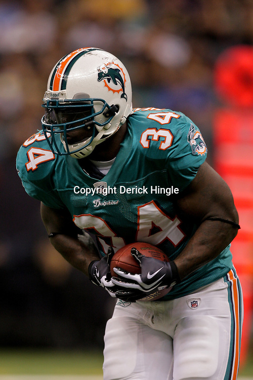 2009 September 03: Miami Dolphins running back Ricky Williams (34) runs with the ball during a preseason game between the Miami Dolphins and the New Orleans Saints at the Louisiana Superdome in New Orleans, Louisiana.