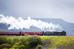 © Licensed to London News Pictures. 07/08/2017. Ribblehead UK. The 46115 Scots Guardsman travels through the Yorkshire Dales this afternoon on a mostly overcast day in Yorkshire. Photo credit: Andrew McCaren/LNP