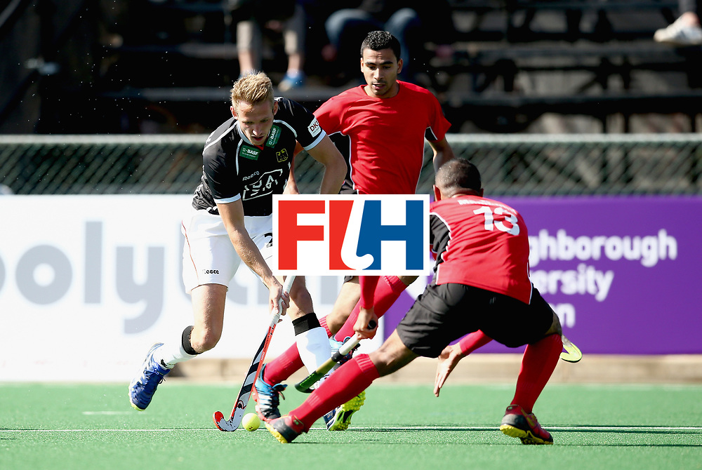 JOHANNESBURG, SOUTH AFRICA - JULY 11: Niklas Wellen of Germany and Mohamed Mamdouh of Egypt battle for possession  during day 2 of the FIH Hockey World League Semi Finals Pool B match between Germany and Egypt at Wits University on July 11, 2017 in Johannesburg, South Africa. (Photo by Jan Kruger/Getty Images for FIH)