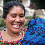 Clara, a local weaver, selling her woven textiles in Parque Central in Antigua, Guatemala.