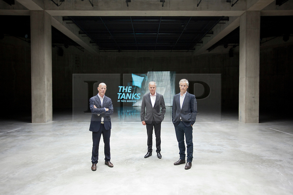 © Licensed to London News Pictures. 16/07/2012.  LONDON, UK. Jacques Hertzog (L), Pierre de Meuron (C) and Ascan Mergenthaler (R) of Swiss architectural firm Herzog & de Meuron stand in one of the gallery's new Tank Room exhibition spaces, designed by their company, in London today (16/07/12). The new rooms, unveiled today mark the first phase of the Tate Modern Project and the beginning of the 15 week 'Art in Action' festival. Photo credit: Matt Cetti-Roberts/LNP