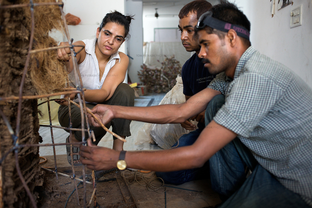 Bharti Kher, contemporary artist in her studio with two of her assistants working on a sculpture. Kher is based in Gurgaon, a satellite town of Delhi and is married to artist Subodh Gupta...Photo: Tom Pietrasik.Gurgaon, Haryana. India. .June 26th 2009