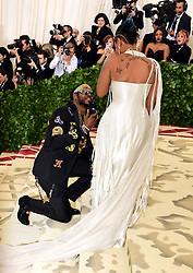 2 Chainz proposes to Kesha Ward on the red carpet at the Metropolitan Museum of Art Costume Institute Benefit Gala 2018 in New York, USA.