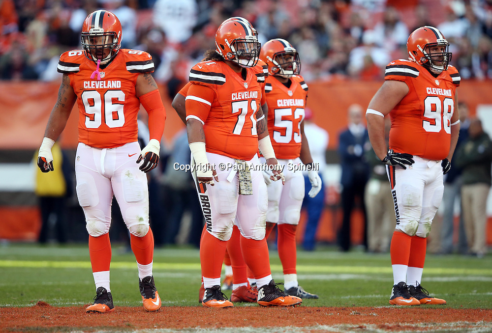 Cleveland Browns defensive tackle Xavier Cooper (96) and Cleveland Browns nose tackle Danny Shelton (71) looks on while with other members of the Browns offensive line during the 2015 week 8 regular season NFL football game against the Arizona Cardinals on Sunday, Nov. 1, 2015 in Cleveland. The Cardinals won the game 34-20. (©Paul Anthony Spinelli)