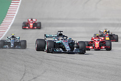 October 21, 2018 - Austin, USA - Mercedes AMG Petronas driver Lewis Hamilton (44) of Great Britain and Scuderia Ferrari driver Kimi Raikkonen (7) of Finland head into the first turn on Lap 1 of the Formula 1 U.S. Grand Prix at the Circuit of the Americas in Austin, Texas on Sunday, Oct. 21, 2018. Raikkonen won the race and Hamilton finished third. (Credit Image: © Scott Coleman/ZUMA Wire)
