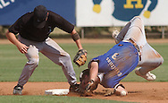 Pueblo Chieftains' Tony Wittmus upends as he slides in safely to second as Long Beach second baseman Mike Svetlic misses the throw on Wittmus' steal attempt in the first inning of an elimination game of the National Baseball Congress World Series at Hobart-Detter Field Sunday.