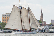 The American Gaff Schooner Spirit of South Carolina passes the historic waterfront during the parade of sails kicking off the Tall Ships Charleston festival May 18, 2017 in Charleston, South Carolina. The festival of tall sailing ships from around the world will spend three-days visiting historic Charleston.