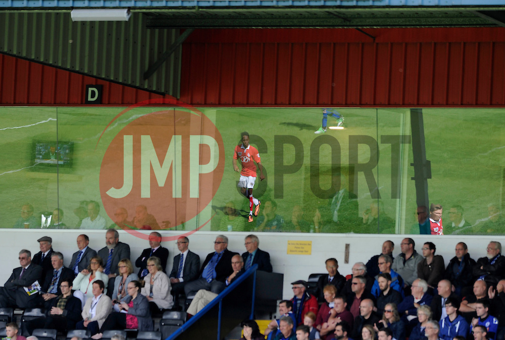Bristol City's Korey Smith's reflection at the Spotland Stadium - Photo mandatory by-line: Dougie Allward/JMP - Mobile: 07966 386802 23/08/2014 - SPORT - FOOTBALL - Manchester - Spotland Stadium - Rochdale AFC v Bristol City - Sky Bet League One