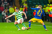 Kieran Tierney (#63) of Celtic FC tackles Konrad Laimer (#27) of RB Leipzig during the Europa League group stage match between Celtic and RP Leipzig at Celtic Park, Glasgow, Scotland on 8 November 2018.
