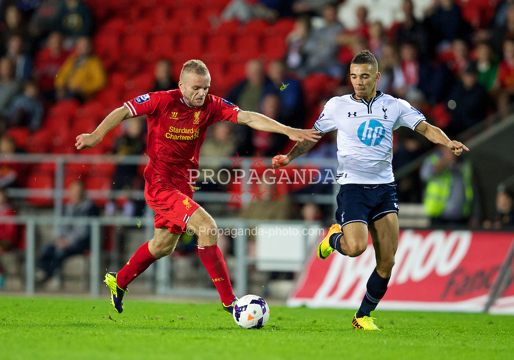 ST HELENS, ENGLAND - Monday, October 7, 2013: Liverpool's Ryan McLaughlin in action against Tottenham Hotspur's Ryan Fredericks during the Under 21 FA Premier League match at Langtree Park. (Pic by David Rawcliffe/Propaganda)