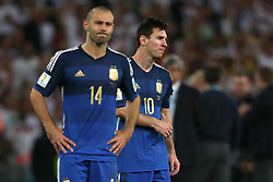13.07.2014, Maracana, Rio de Janeiro, BRA, FIFA WM, Deutschland vs Argentinien, Finale, im Bild vl. Enttaeuschung bei Javier Mascherano (ARG) und Lionel Messi (ARG) nach dem Schlusspfiff in Maracana. // during Final match between Germany and Argentina of the FIFA Worldcup Brazil 2014 at the Maracana in Rio de Janeiro, Brazil on 2014/07/13. EXPA Pictures © 2014, PhotoCredit: EXPA/ Eibner-Pressefoto/ Cezaro<br /> <br /> *****ATTENTION - OUT of GER*****