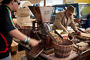 A local coffee producer demonstrates coffee processing at the Mariaco Coffee Festival in Puerto Rico.