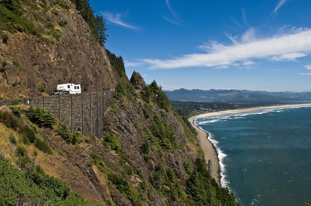 Historic Rockwork on Highway 101, with 5th wheel RV on road, at Neakahnie Mountain near Manzanita on the Oregon Coast.