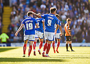 Portsmouth match winner Conor Chaplin is congratulated by Matt Tubbs after scoring his second goal during the Sky Bet League 2 match between Portsmouth and Barnet at Fratton Park, Portsmouth, England on 12 September 2015. Photo by David Charbit.