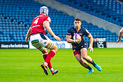 Damien Hoyland (#15) of Edinburgh Rugby runs at Pierce Phillips (#4) of SU Agen Rugby during the European Rugby Challenge Cup match between Edinburgh Rugby and SU Agen at BT Murrayfield, Edinburgh, Scotland on 18 January 2020.