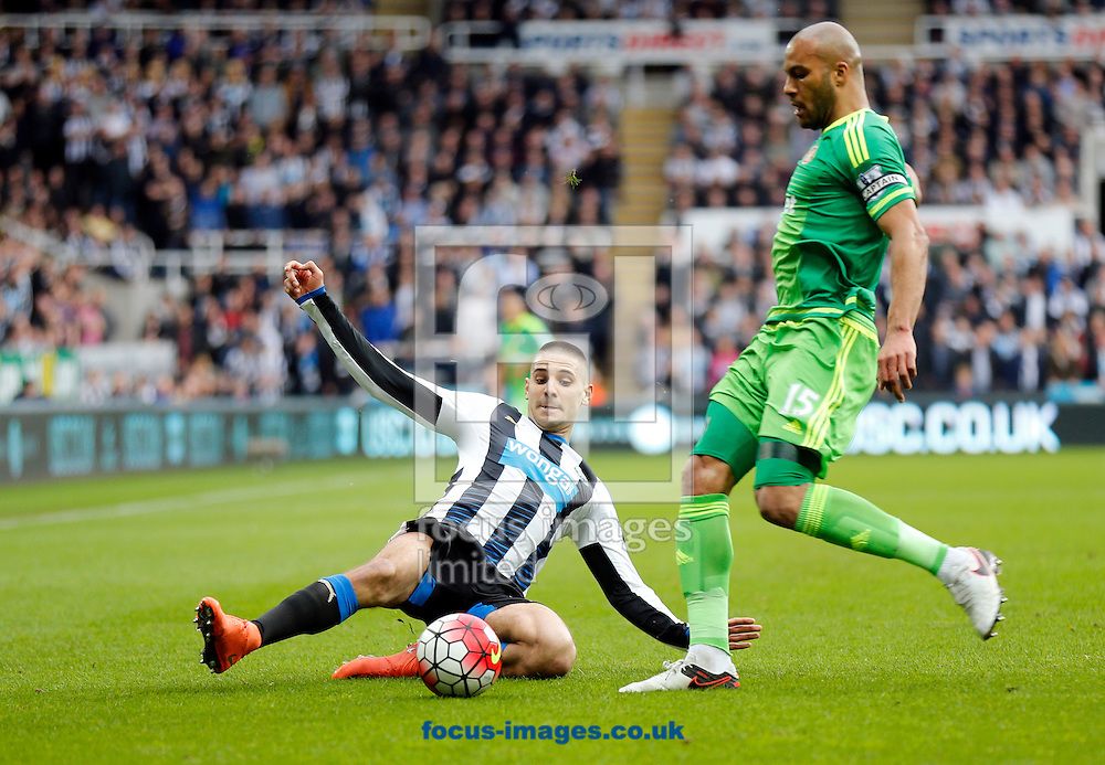 Aleksandar Mitrovic (l) of Newcastle United and Younes Kaboul of Sunderland during the Barclays Premier League match at St. James's Park, Newcastle<br /> Picture by Simon Moore/Focus Images Ltd 07807 671782<br /> 20/03/2016