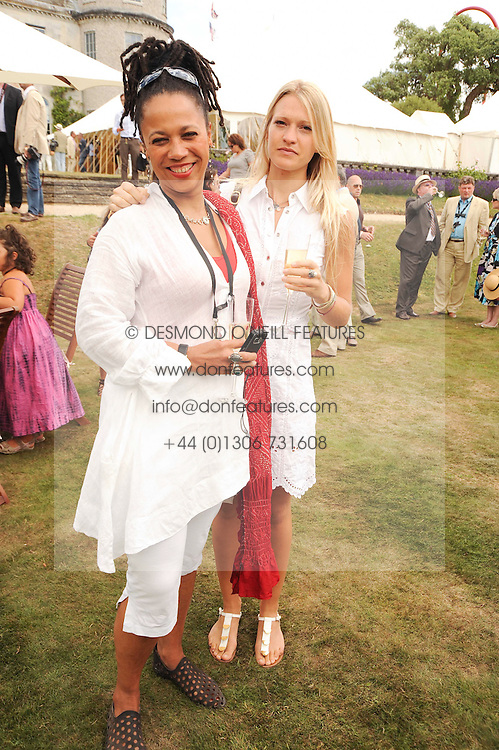 Left to right, NIMMY MARCH and LADY ALEXANDRA GORDON-LENNOX at a luncheon hosted by Cartier for their sponsorship of the Style et Luxe part of the Goodwood Festival of Speed at Goodwood House, West Sussex on 4th July 2010.