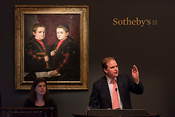 "© Licensed to London News Pictures. 07/12/2016. London, UK. ""Portrait of Two Boys, said to be members of the Pesaro Family"" by Tiziano Vecellio, called Titian and workshop sold for a hammer price of GBP 1.175m (est. GBP 1-1.5m) at the Old Masters Evening Sale at Sotheby's in New Bond Street. Photo credit : Stephen Chung/LNP"