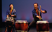 "Members of Portland Taiko perform at the 2011 concert ""Drums@Work, Drums@Play"", Winningstad Theatre, Portland Center for the Performing Arts, Portland, Oregon"