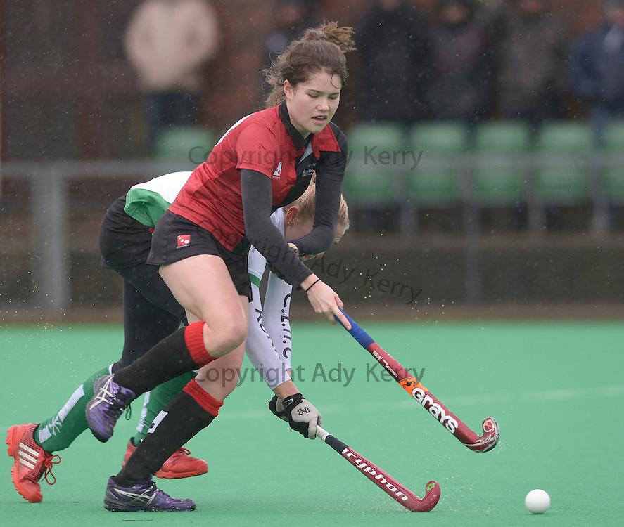 Bowdon's Holly Hunt  is challeneged by Canterbury's Susie Rowe (R)during their Investec Women's Hockey League Premier Division game at Canterbury HC, 8th February 2014.