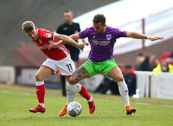 Joe Bryan of Bristol City takes on Lloyd Isgrove of Barnsley - Mandatory by-line: Robbie Stephenson/JMP - 30/03/2018 - FOOTBALL - Oakwell Stadium - Barnsley, England - Barnsley v Bristol City - Sky Bet Championship